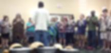 Sowah Mensah leads a group at a World Music Drumming workshop