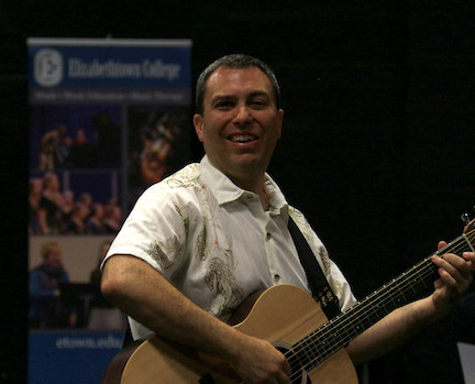 Michael Checco Playing Guitar