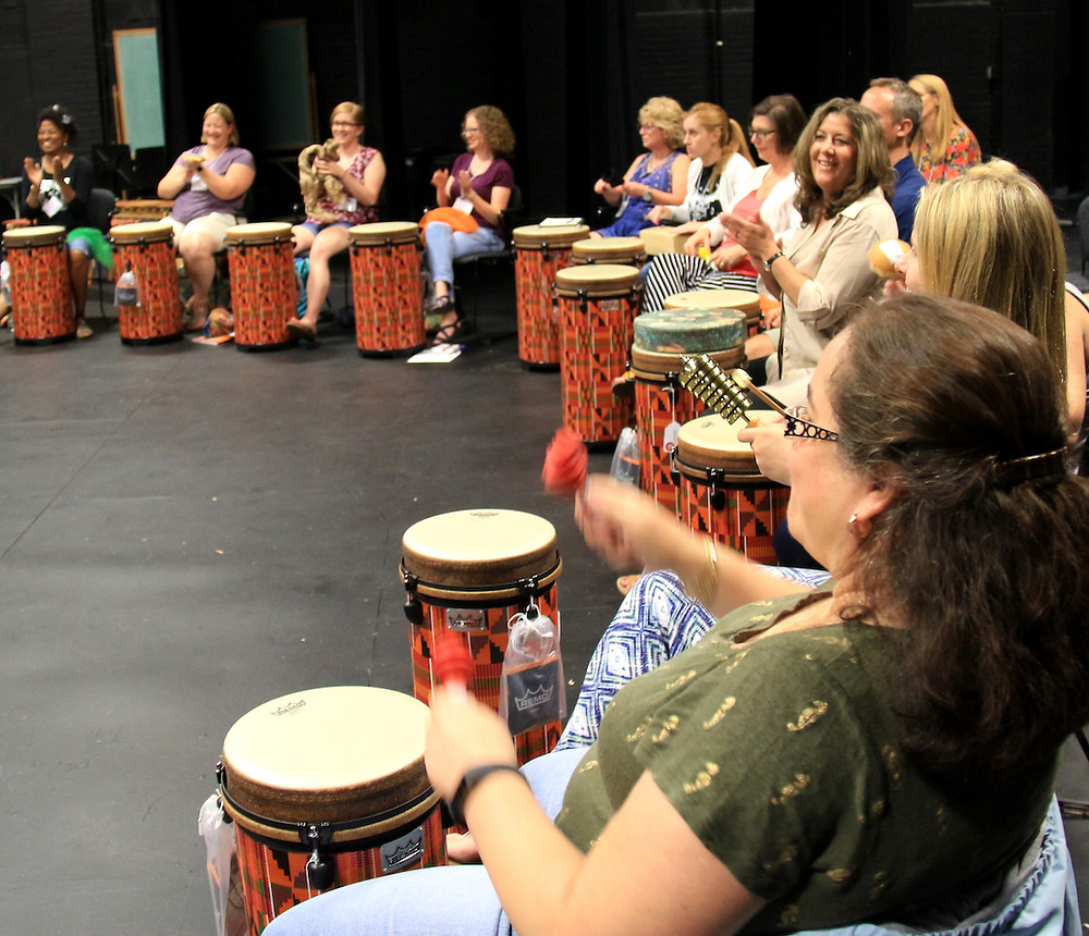 Participants engaged in World Music Drumming