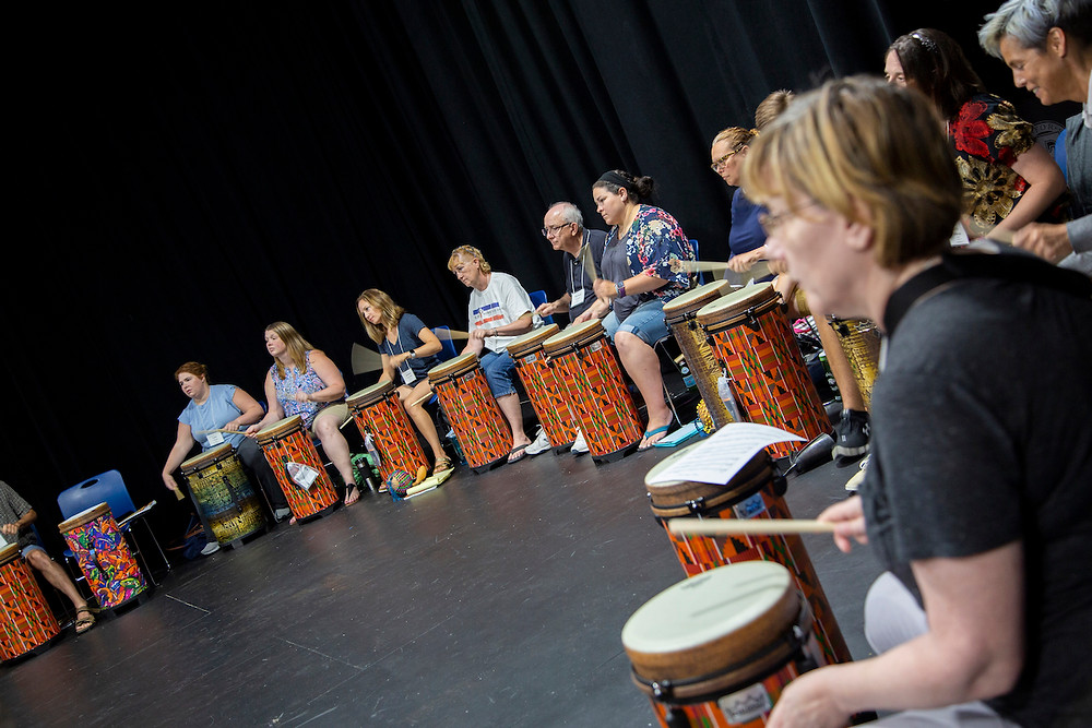 Participants drumming during a World Music Drumming Workshop