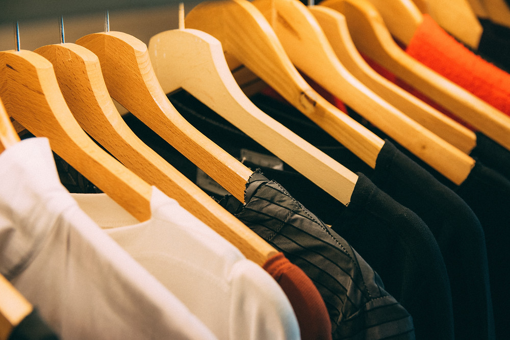 clothes on wooden hangers, free image courtesy of Pexels