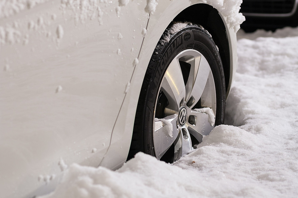 wheel of car stuck in snow