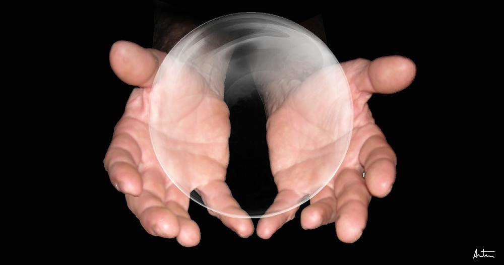 Hands holding clear sphere