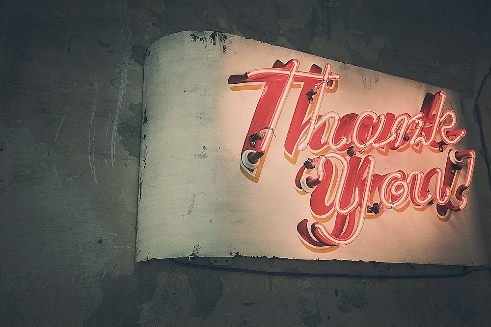 "neon sign that says ""Thank You!"""