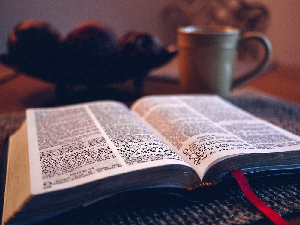 Bible on table open to book of Psalms