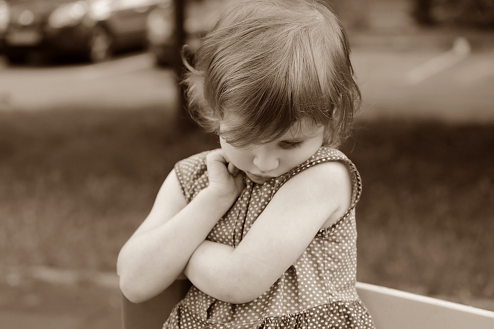 Little girl, head down, acting shy