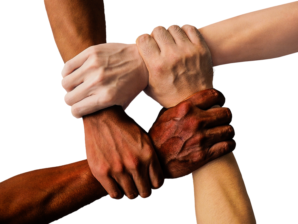 four arms of people of differing skin color, each grasping the other's wrist, making an empty square in the middle