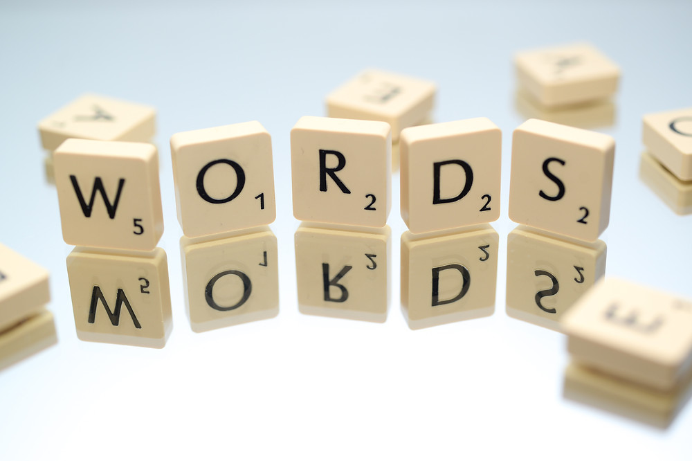 "Scrabble pieces spelling the word ""WORDS"""