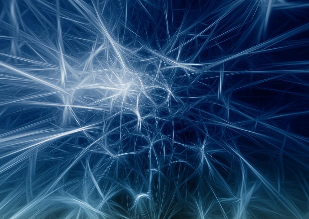 dark blue-black background with white light sparks