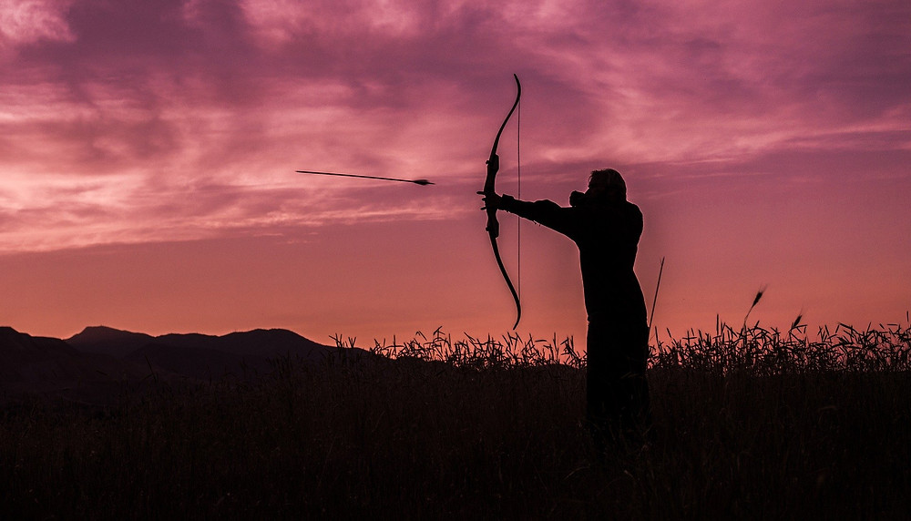 silhouette of archer shooting arrow