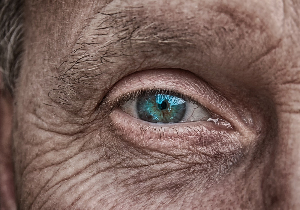 blue-green eye of old person