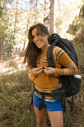 missouri girl laughing, buckling backpack, overnight camp trip, vacation hikers, hiking trails branson mo