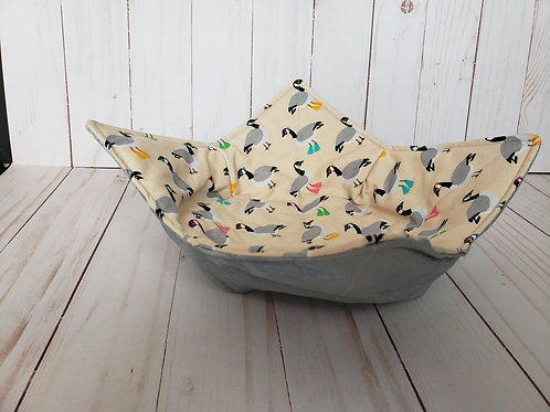 fabric bowl with ducks on one side and grey on the other