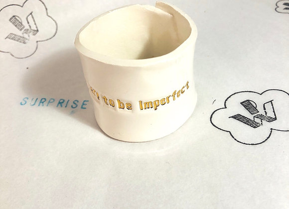 Surprise Rond de serviette Dare to be imperfect