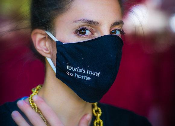 Masque Tourist Must Go Home