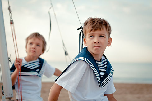 Portrait of young sailors near yacht, ou