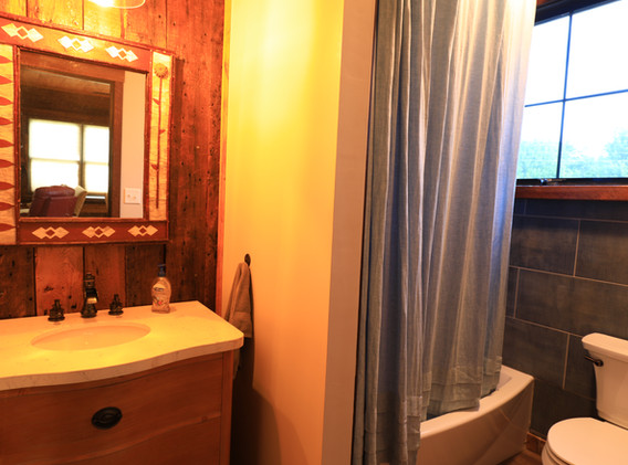 Bathroom with tiled tub & shower