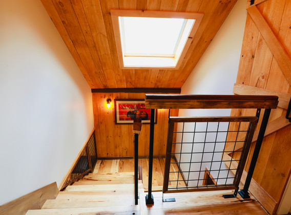 Looking down center Stairway with Skylight