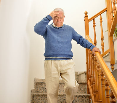 senior man coming down the stairs and ha