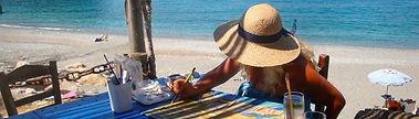 Girl paining on a beach in Samos, Greece