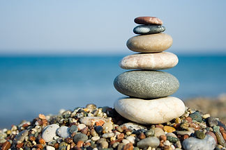 Pebble stones, one on top of the other on a beach