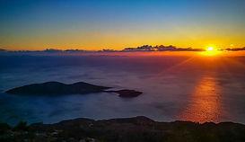 Sun set in Samos Greece, overlooking the island of Samiopoula