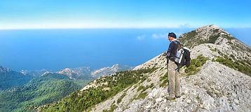 Man on the top of mountain Kerkis in Samos, Greece
