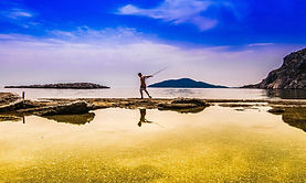 Man fishing in Tsopela beach in Samos, Greece