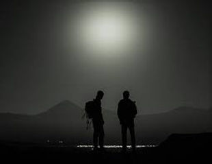 Men standing on the moonlight, hikig in Samos, Greece