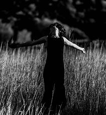 Black and white photo of a woman in a field