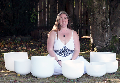 marissa with bowls in grass.png