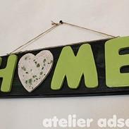 Schild HOME