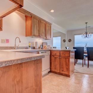 Condo 31 Kitchen-Dining Room View.jpg