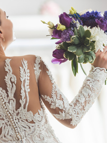 rear-view-of-bride-in-lace-dress-with-fl