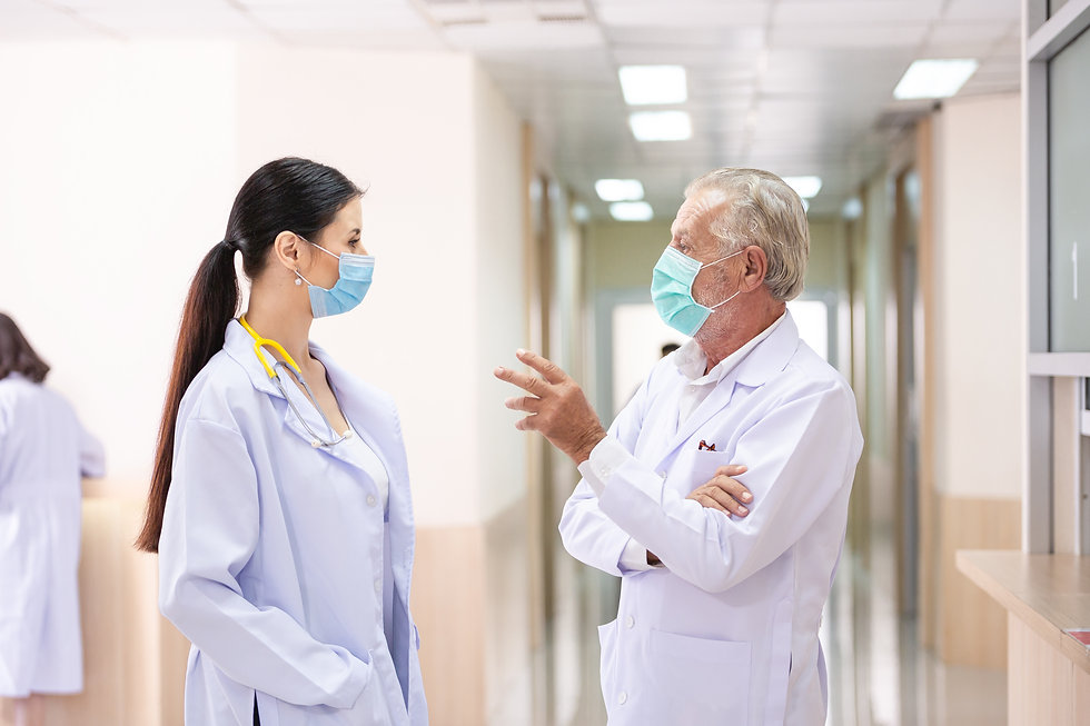 senior-doctor-talking-with-female-doctor