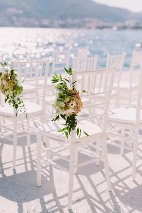 white-wedding-chairs-outdoors-venue-L268