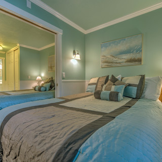 Unit 21 Master Bedroom. Two Queen Beds.j