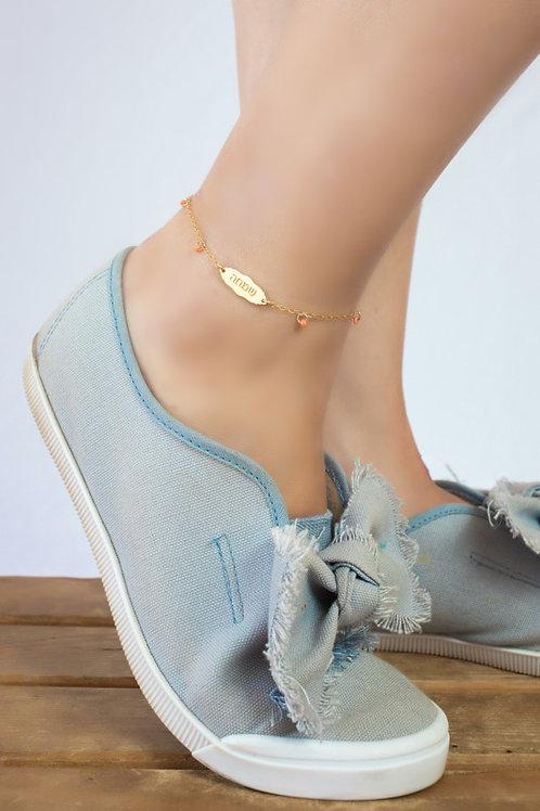צמיד רגל פתק קטן בגוון זהב