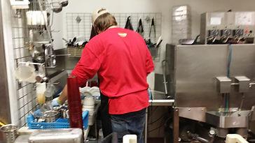 Michael washing dishes a wok
