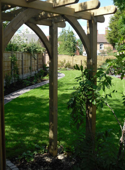 Archway leading to vegetable garden