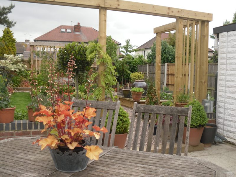 Pergola to create a courtyard intimate feel to patio area leading to garden and veg area