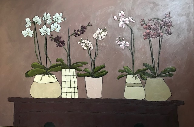 Five Orchids on a table,