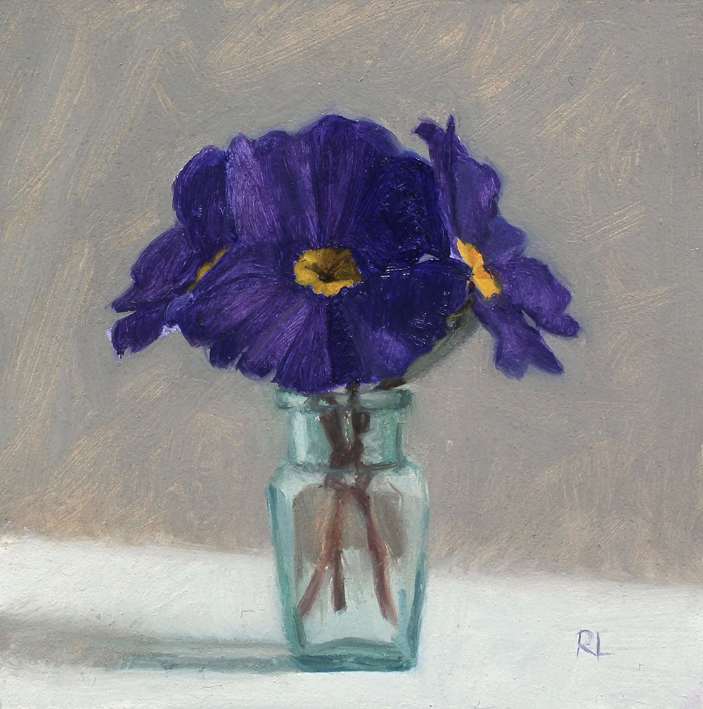 Purple Primulas in a Glass Bottle