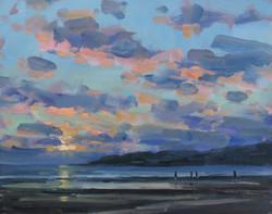 Sun setting behind Lyme Regis