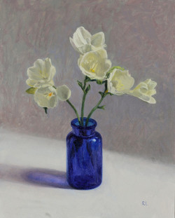 Freesias in a Blue Glass Bottle