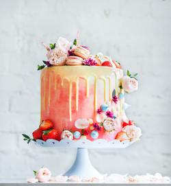 Wedding cake with flowers macarons and b
