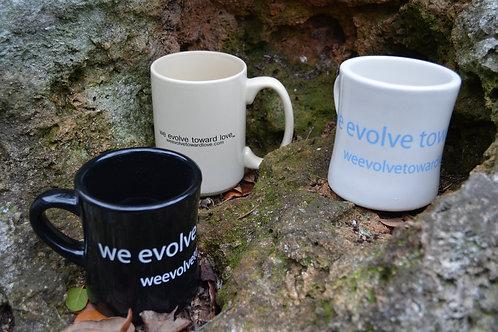 we evolve toward love® coffee mug pick one