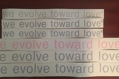 we evolve toward love® bumper sticker-permanent