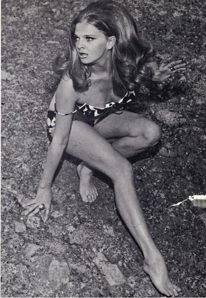 Eva in bathinsuit on ground.jpg