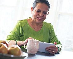 older-woman-with-coffee-and-laptop-mt201
